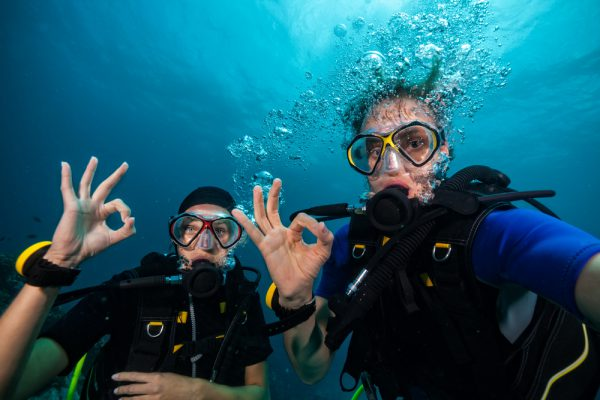 Divers Showing OK Sign