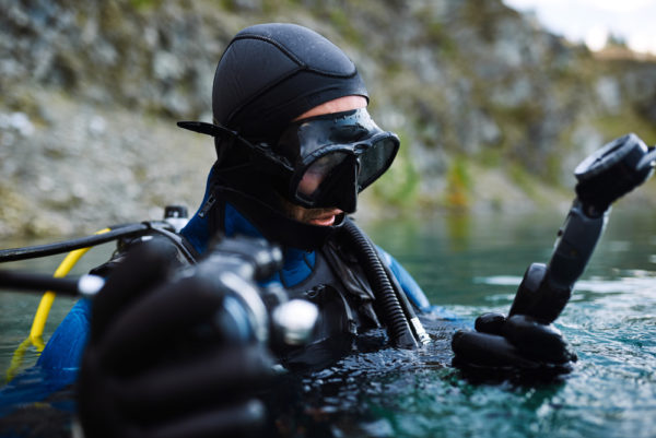 Diver Checking Air Gauge Before Immersing