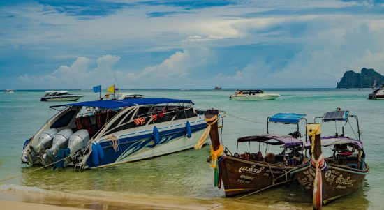 Traditional Thai Longtail Boats and Speed Boats